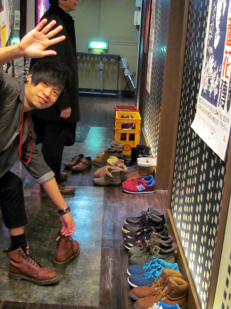 Students trying to line up their shoes nicely outside the tatami room